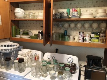 Cabinets full of dishes to sort